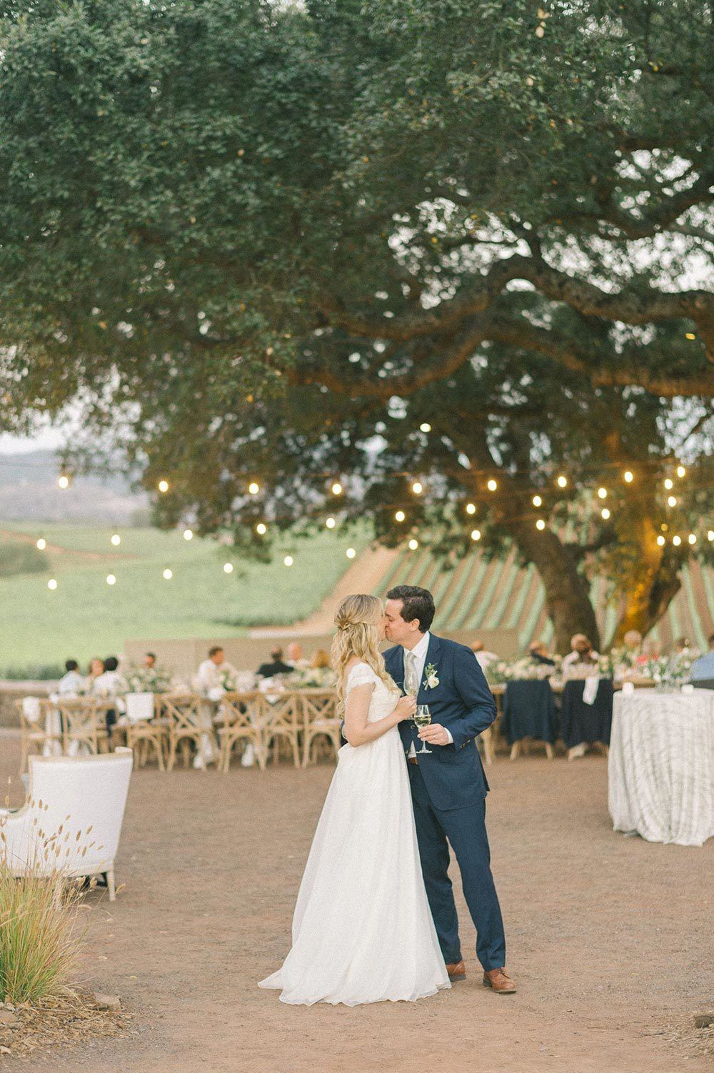 Sonoma Valley wedding al fresco reception with market lights and bride and groom