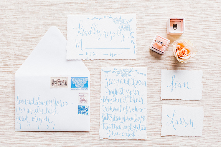 wedding stationery with blue calligraphy - https://ruffledblog.com/winery-vow-renewal-inspiration-with-autumn-leaves
