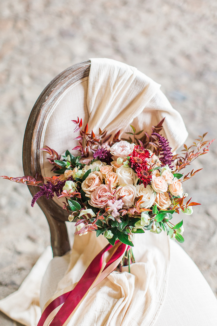 dramatic fall wedding bouquets - https://ruffledblog.com/winery-vow-renewal-inspiration-with-autumn-leaves