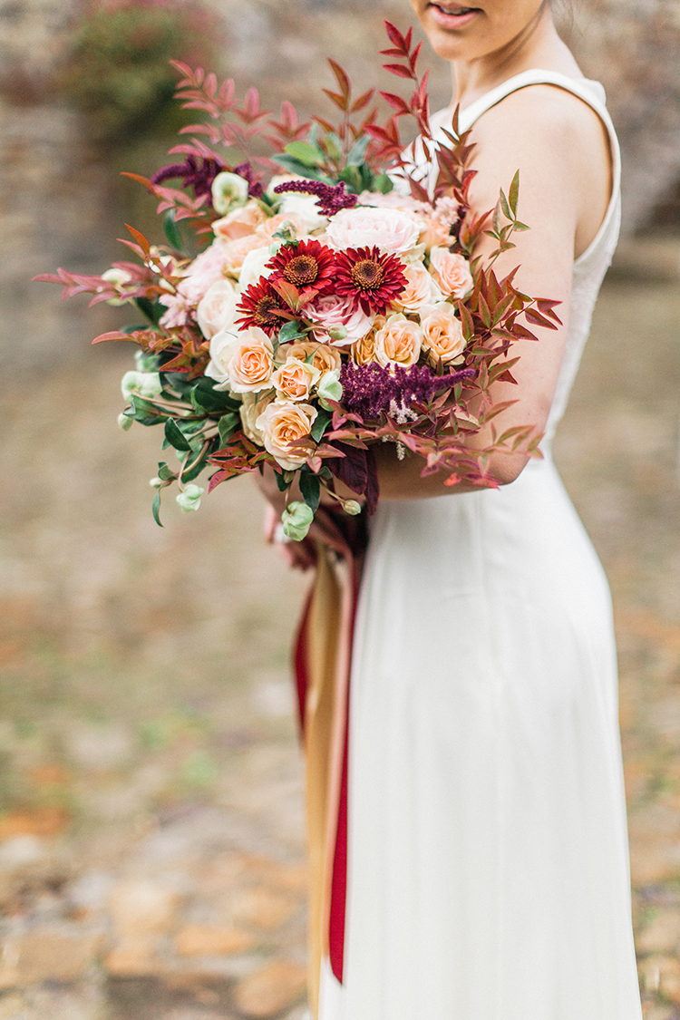beautiful fall wedding bouquets - https://ruffledblog.com/winery-vow-renewal-inspiration-with-autumn-leaves