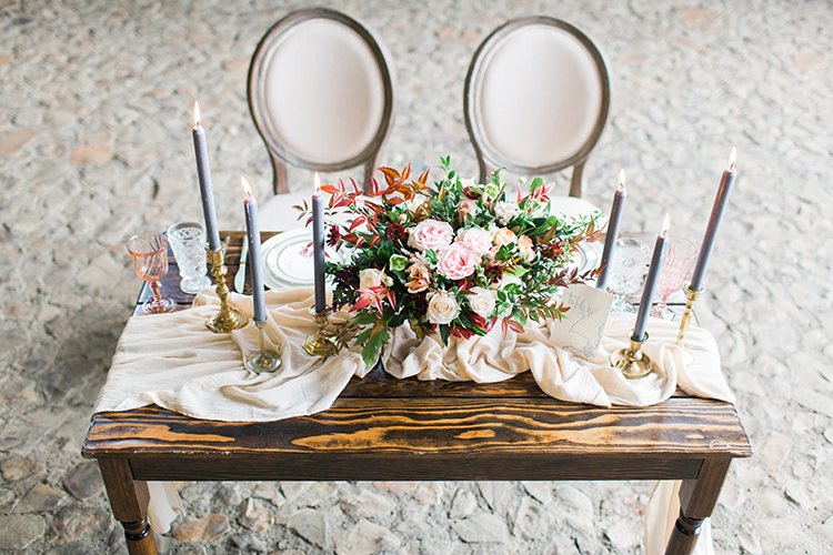 romantic fall wedding tablescapes - https://ruffledblog.com/winery-vow-renewal-inspiration-with-autumn-leaves
