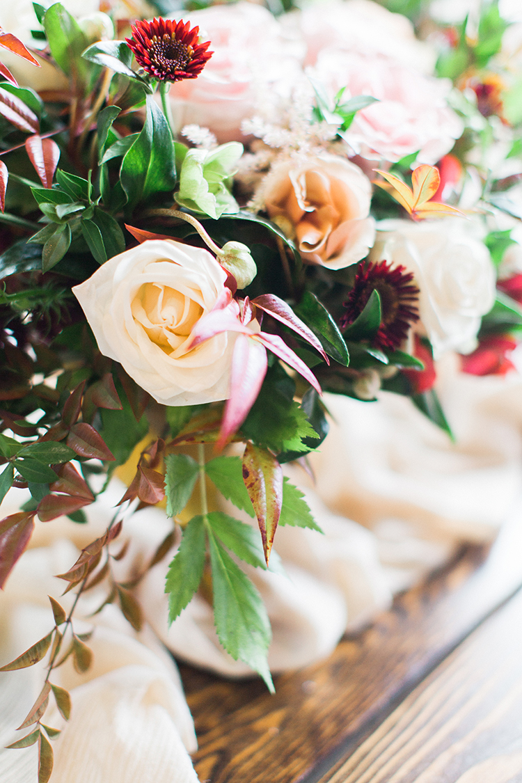 pink rose centerpieces - https://ruffledblog.com/winery-vow-renewal-inspiration-with-autumn-leaves