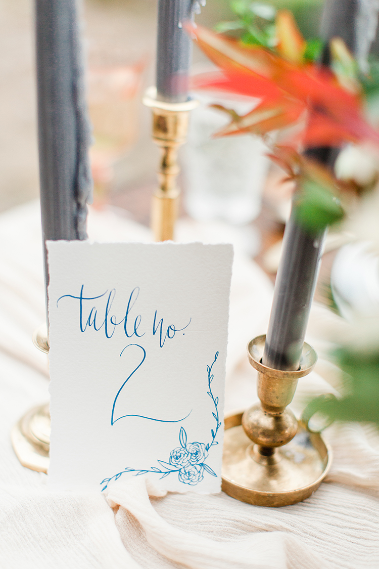 handwritten table numbers - https://ruffledblog.com/winery-vow-renewal-inspiration-with-autumn-leaves