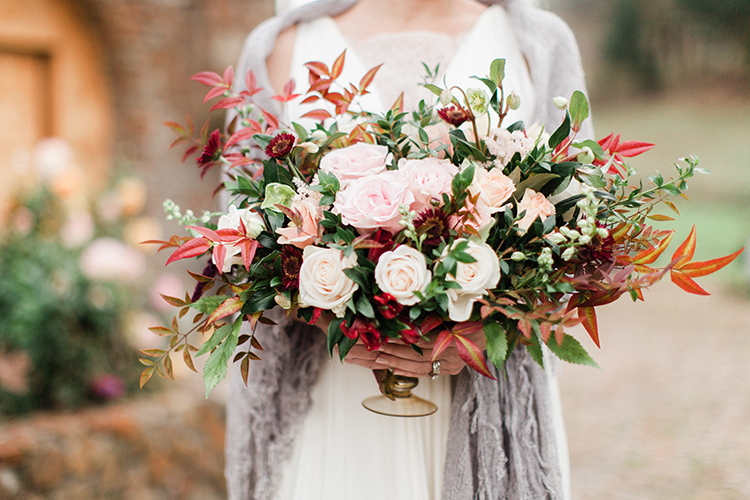 fall wedding centerpieces - https://ruffledblog.com/winery-vow-renewal-inspiration-with-autumn-leaves