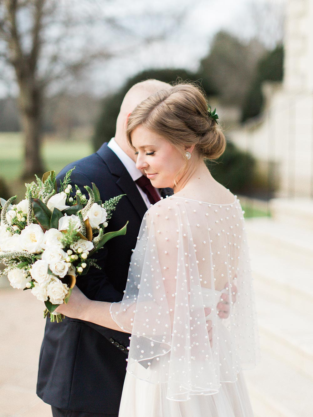 sheer embellished bridal cape with all-white bouquet