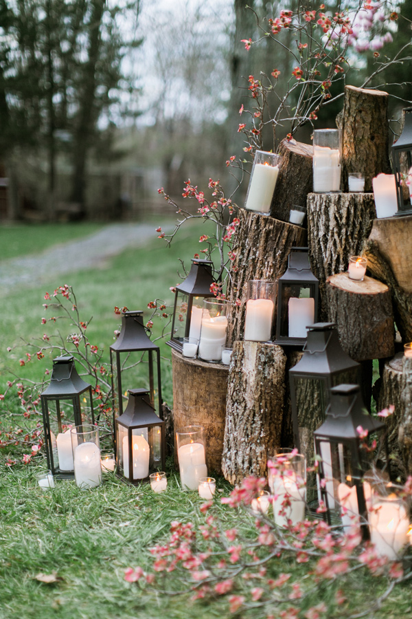 lantern and candle ceremony backdrop - photo by Emily Wren https://ruffledblog.com/woodland-romance-wedding-inspiration